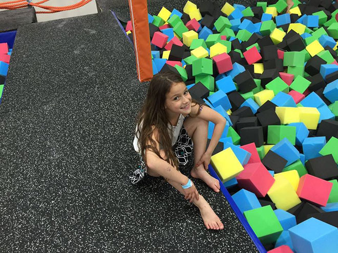 kids smail in the trampoline park
