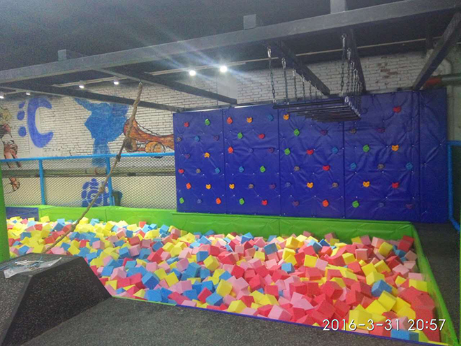 indoor trampoline park with climing wall