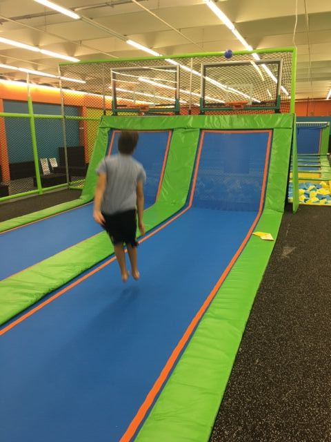 Indoor trampoline park with basketball